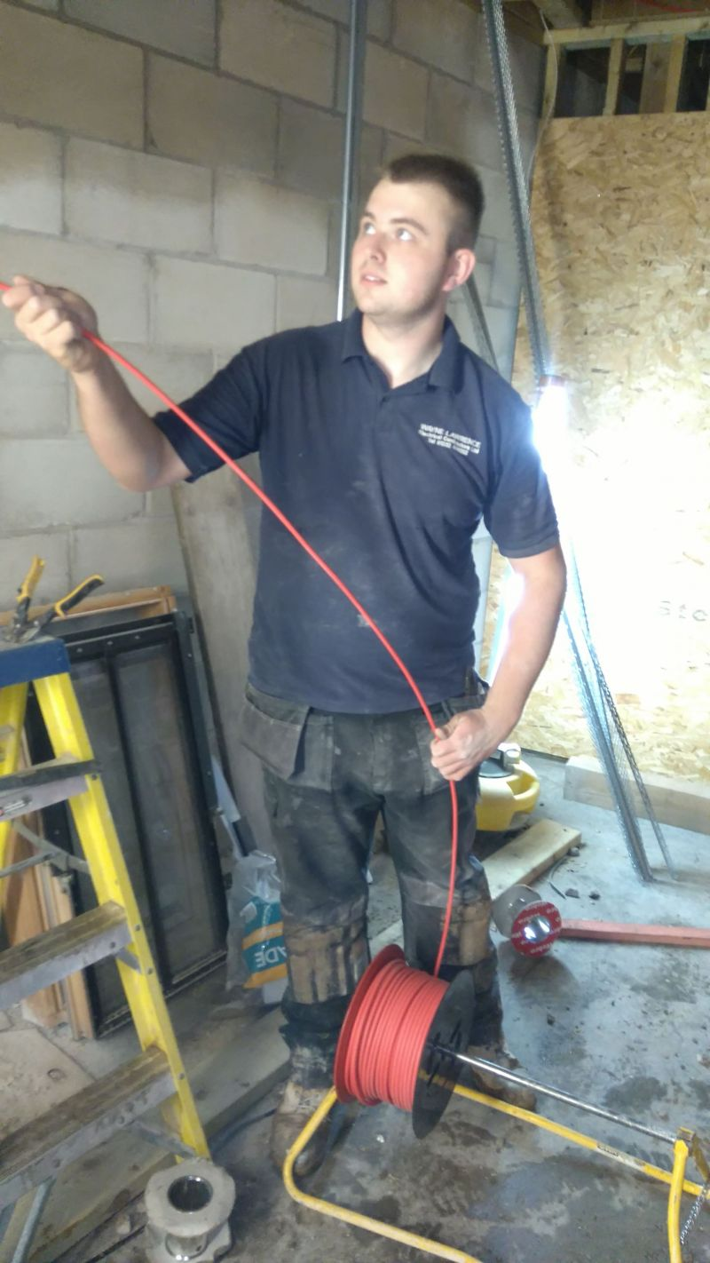 Josh installing Fire Alarm cables: Swipe To View More Images