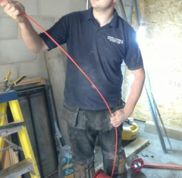Josh installing Fire Alarm cables: Click Here To View Larger Image